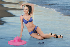 Pretty brunette in blue bikini with arm Stock Photography