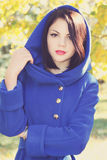 Pretty Brunette in a blue coat,tinted Stock Photo