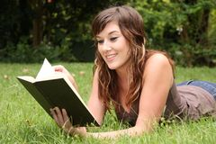 Pretty Brunette Book Reader Stock Photo