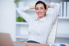 Pretty brunette businesswoman relax Stock Images
