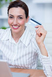 Pretty brunette businesswoman using her credit card Stock Photos