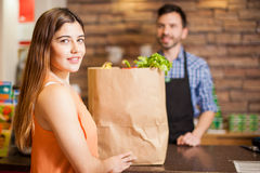 Pretty brunette buying some groceries Royalty Free Stock Photography