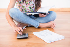 Pretty brunette calculating home finances Royalty Free Stock Image