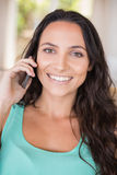 Pretty brunette calling with her mobile phone Royalty Free Stock Photography