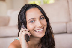 Pretty brunette calling with her mobile phone Royalty Free Stock Image