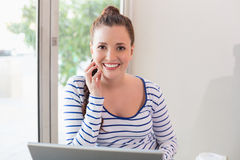 Pretty brunette catching up on work Royalty Free Stock Photo