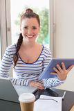 Pretty brunette catching up on work Royalty Free Stock Photography