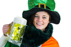 Pretty brunette celebrating Saint Patricks day stock photo