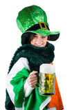 Pretty brunette celebrating Saint Patricks day stock photography
