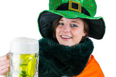 Pretty brunette celebrating Saint Patricks day royalty free stock photography