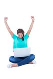 Pretty brunette cheering in front of camera Stock Photography