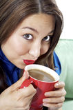 Pretty Brunette with Coffee. Pretty Asian Hispanic Women enjoying her morning cup of coffee with a big smile on her face Royalty Free Stock Image