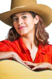 Pretty brunette cowgirl with a guitar Royalty Free Stock Photography