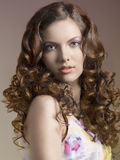 Pretty brunette with curly hair Royalty Free Stock Images