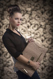 Fashion brunette with bag turned of three quarters Royalty Free Stock Image