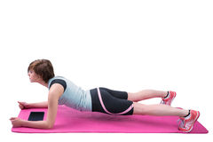 Pretty brunette doing plank on fitness mat Royalty Free Stock Image