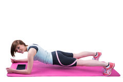 Pretty brunette doing plank on fitness mat Royalty Free Stock Photography