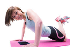 Pretty brunette doing press up on fitness mat Royalty Free Stock Photography