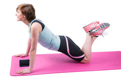 Pretty brunette doing press up on fitness mat Royalty Free Stock Photo