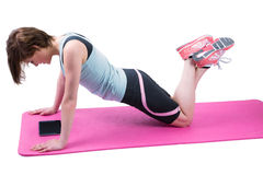 Pretty brunette doing press up on fitness mat Royalty Free Stock Photos