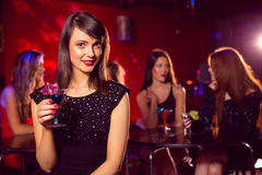 Pretty brunette drinking a cocktail Royalty Free Stock Images