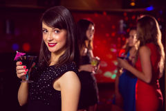 Pretty brunette drinking a cocktail Royalty Free Stock Photo