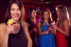 Pretty brunette drinking a cocktail Royalty Free Stock Photography