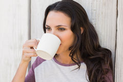 Pretty brunette drinking from mug Royalty Free Stock Photography