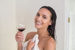 Pretty brunette drinking red wine Royalty Free Stock Images