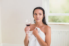 Pretty brunette drinking red wine Royalty Free Stock Image