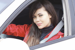 Pretty brunette driving a car Royalty Free Stock Photos