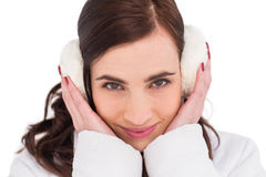 Pretty brunette with ear muffs Royalty Free Stock Images
