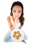 Pretty brunette eating plate of cookies Stock Photos