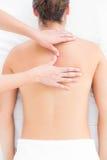 Pretty brunette enjoying a back massage Royalty Free Stock Image