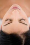 Pretty brunette enjoying a massage Stock Image