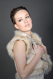 Pretty Brunette in Fake Fur Gillet Stock Image