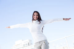 Pretty brunette feeling the air with arms raised up Royalty Free Stock Photo