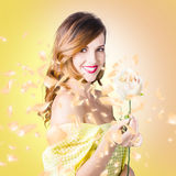 Pretty brunette female holding magic rose blossom Royalty Free Stock Photography