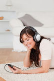 Pretty brunette female listening to music Stock Images