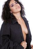 Pretty brunette female wearing men's shirt stock image