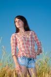 Pretty brunette in a field Stock Photos