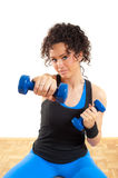 Pretty brunette fitness girl with weights Royalty Free Stock Photo