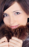 Pretty brunette in fur Stock Images