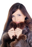 Pretty brunette in fur over white Stock Photography