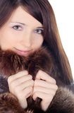 Pretty brunette in fur over white Royalty Free Stock Photos
