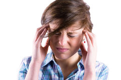 Pretty brunette getting a headache with hands on head Royalty Free Stock Photos