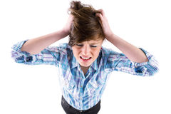 Pretty brunette getting a headache with hands on head Royalty Free Stock Image