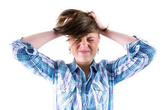 Pretty brunette getting a headache with hands on head Stock Photography