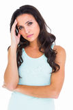 Pretty brunette getting a headache Royalty Free Stock Images