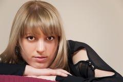 Pretty brunette girl on bed Stock Photo